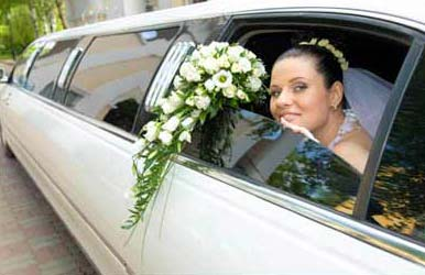 Bride in white limousine