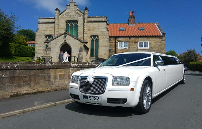 Chrysler Limousine outside Church after wedding